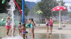 Parent Observing and Filming Children in Play at Waterpark Stock Footage