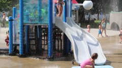 Young Children on Water Park Slide Stock Footage