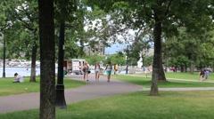 Women Walking Through Lakeside Park Stock Footage