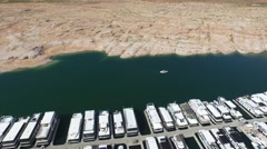 Drone aerial pulling away from boats docked in Lake Powell Stock Footage