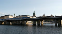 Metro passing by with Gamla stan islands in the background Stock Footage