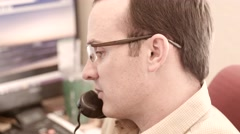 A male talking on his phone in his office Stock Footage