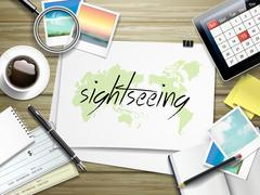 sightseeing word written on paper - stock illustration