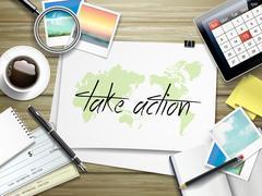 Stock Illustration of take action written on paper