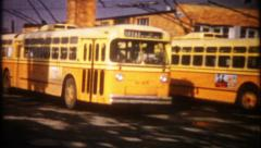 Big city transit bus yard and garage, 2343 vintage film home movie Stock Footage