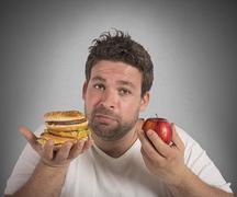 Diet vs junk food - stock photo