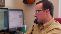 A man talking on a phone in his office Stock Footage