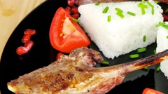 Grilled ribs with rice and tomatoes Stock Footage