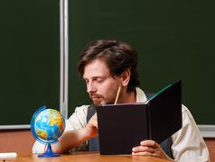 Stock Photo of Man. Geography teacher.