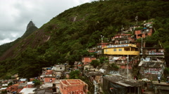 Time lapse looking past the favelas up to Cristo Redentor on the mountain top. - stock footage