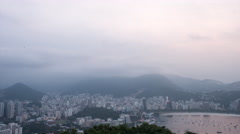 Time lapse view from Sugar Loaf over looking Rio, Brazil on a cloudy evening at Stock Footage