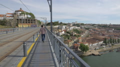 Men and women walking on Dom Luis Bridge in Porto Stock Footage