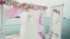 Wedding dress hanging in outdoor decorations Stock Footage