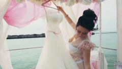 Bride and her dress in outdoor photo decorations Stock Footage