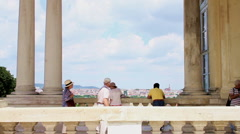 Tourists looking towards Schonbrunn Castle from the Gloriette Stock Footage