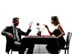 Couples lovers dating dinner  dispute arguing Stock Photos