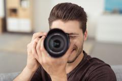 Male Photographer Taking Picture Using DSLR Camera - stock photo