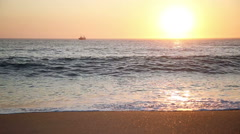 Beautiful sunset over a wavy ocean Stock Footage