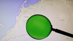 Angola and its capital Luanda seen trough a green magnifying glass - stock footage