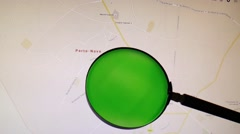 Benin and its capital Porto-Novo seen trough a green magnifying glass Stock Footage