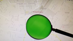 Burkina Faso and its capital Ouagadougou seen trough a green magnifying glass Stock Footage