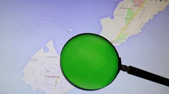 Guinea and its capital Conakry seen trough a green magnifying glass Stock Footage
