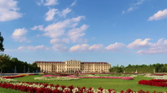 Real time view of Schonbrunn castle begind the flowers in the garden Stock Footage