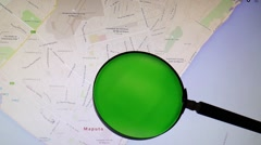 Mozambique and its capital Maputo seen trough a green magnifying glass Stock Footage