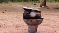 Pot brewing in Africa. Stock Footage
