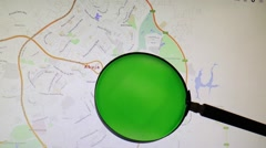 Nigeria and its capital Abuja seen trough a green magnifying glass Stock Footage