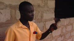 African boy ringing school bell. Arkistovideo
