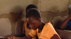African girl reading in school. - stock footage