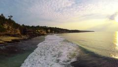 Waves in front of Cliffs and Beach in Bali flyover Stock Footage