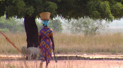 African woman walking with a machete. Stock Footage