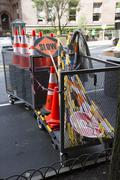 Roadside storage of cones stop and slow sign boards Stock Photos