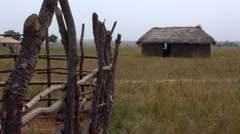 A grassy hut and fence in Africa. Stock Footage