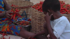 African boy sorting chili peppers. Stock Footage