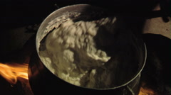 Food being stirred in a pot in Africa. Stock Footage