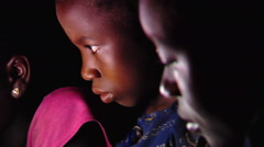 African children reading by a lamp. Stock Footage