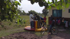 African children playing on a merry go round. Stock Footage