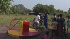 African men fixing a merry go round. Stock Footage