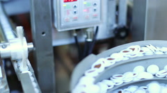 Production line with the packaged capsules at the coffee factory Stock Footage