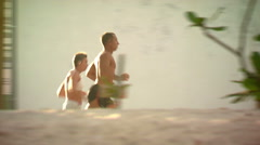 Two joggers by a beach in Bali. Stock Footage