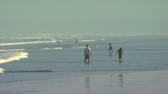Clip of people in the water at a beach in Bali. Stock Footage