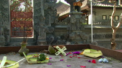 Messy table with a stone wall in the background in Bali. Stock Footage