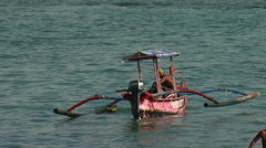 Fishing boat off a beach in Bali. Stock Footage