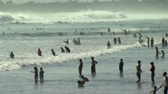 Many people in the water at a beach in Bali. Stock Footage