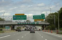 Approaching tollbooths warning road signs New York USA Stock Photos