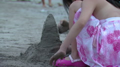 Girl building a sand castle in Bali. Stock Footage