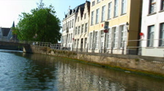 Buildings lining a canal in Bruges, Belgium. Stock Footage